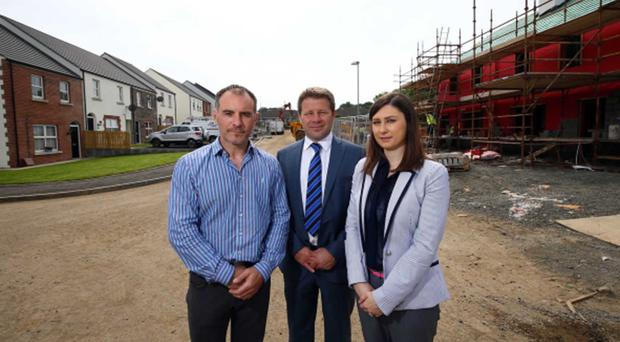 James Patterson of Cultra Developments at the new homes in Ballyclare with Kenton Hilman and Oonagh Potter of Ulster Bank