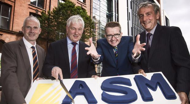 From left, ASM founders Michael McAllister, Stephen Sproule and (far right) Norman Adams, with entertainer David Meade. Mentalist Meade helped the company mark their recent 20th birthday