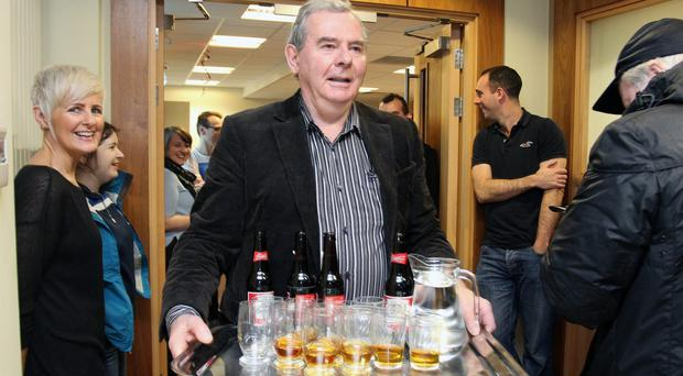 Sean Quinn arrives with drinks at the Quinn Group former HQ last December. Below, Liam McCaffrey