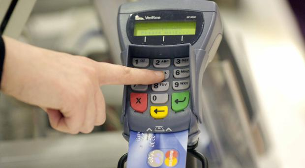 A shopper using their debit card