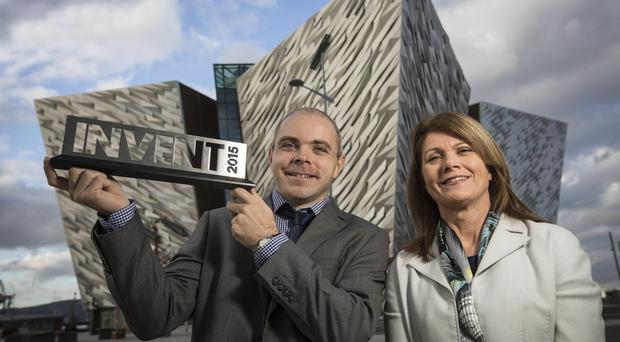 Neil Hanley from PicoPUF receives the Invent award from Bank of Ireland's Julie Ann O'Hare at Titanic Belfast