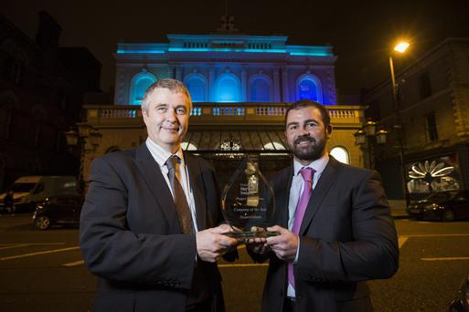Neurovalens founder Jason McKeown receives his award from Invest NI board member Padraig Canavan yesterday
