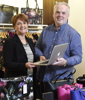 Grainne McVeigh, Invest NI's director of consumer products, with William Gilliland, managing director of Excel Clothing