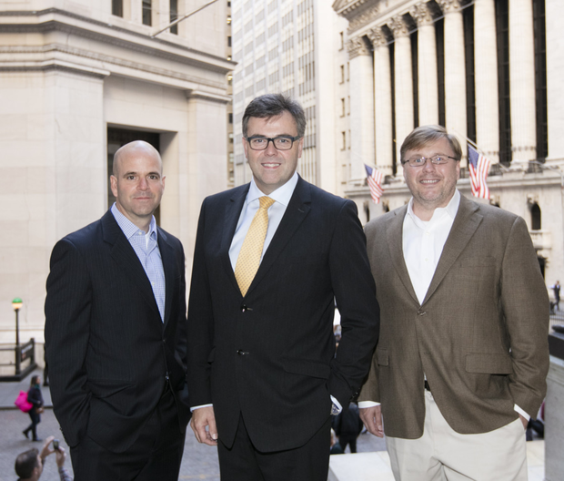 At New York Stock Exchange headquarters on Wall Street are (from left) Michael Hollingsworth of Hanweck Associates with Invest NI chief Alastair Hamilton and founder Gerald Hanweck