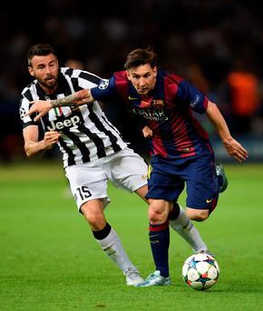 Barcelona's Lionel Messi goes past Andrea Barzagli, of Juventus, during the Champions League Final in June