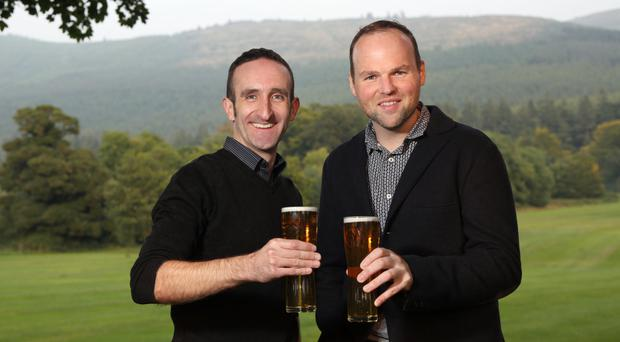 Enjoying a pint of Mourne Gold, one of the brewery's core beers, is master brewer Tom Ray (left) with Connaire McGreevy, founder of Mourne Mountains Brewery