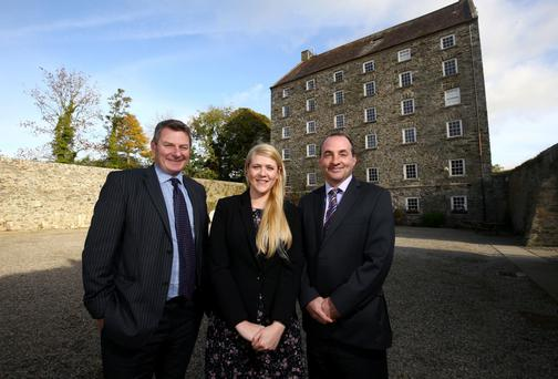 Mary Hinds, assistant manager at Ballydugan Mill, with Ulster Bank's Girvan Gault, left, and Derick Wilson, right
