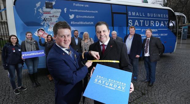 Glyn Roberts (right) of NIIRTA with Chris Suitor, owner of Suitor Menswear, promoting Small Business Saturday UK on December 5