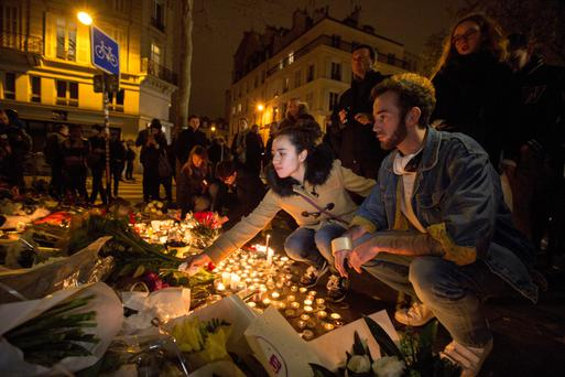 Flowers are laid at the Bataclan Theatre where many music fans died