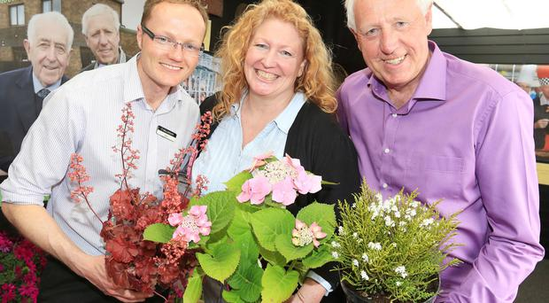 Alan Mercer with his father, Robin, and celebrity Charlie Dimmock who visited the store over the summer