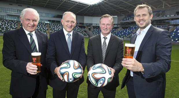 Brian Beattie (right) with IFA officials