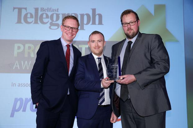 Andrew Coggins (left) and Gavin Elliott of CBRE are presented with their award by Neil Logan (centre), partner at category sponsor Wilson Nesbitt Solicitors