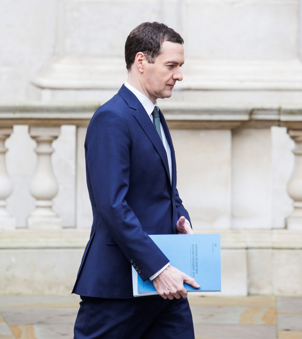 Chancellor George Osborne leaves the Treasury for the House of Commons yesterday to deliver his Autumn Statement