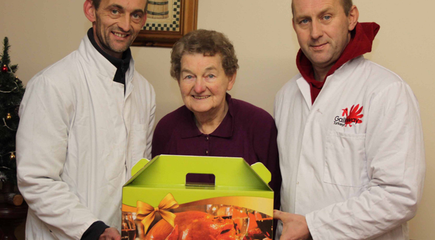 Thomas, Lena and John Galloway show off their branded boxes. The family gets 4,000 turkeys ready for Christmas dinners (left) in just four days