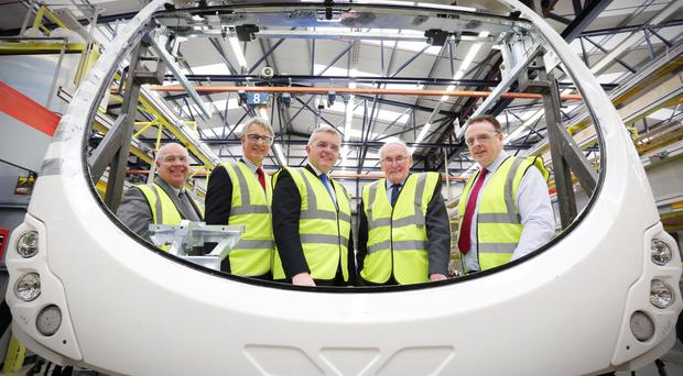 Enterprise Minister Jonathan Bell with Ian Murphy from Invest NI and Mark Nodder, William Wright and Steven Francey of Wrightbus