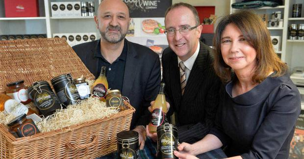 Des Gartland of Invest NI (centre) with Nicholas and Michelle Lestas of Good Food & Wine Company