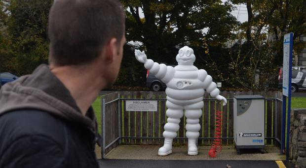 A worker leaves the Michelin plant in Ballymena
