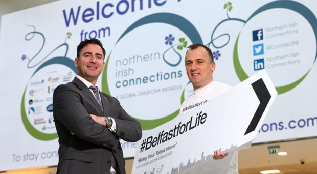 Andrew Cowan, chief executive of Northern Irish Connections and Alan Braithwaite, business director at Abacus Professional Recruitment, showcase #BelfastforLife to expats returning home to Northern Ireland at George Best Belfast City Airport