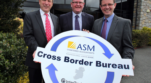 Paddy Savage of InterTradeIreland (centre) with Michael O'Hare and Ronan McGuirk of ASM Chartered Accountants;