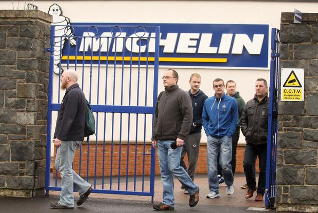 Workers leave the Michelin tyre factory in Ballymena, Co Antrim, after the announcement production will finish in 2018