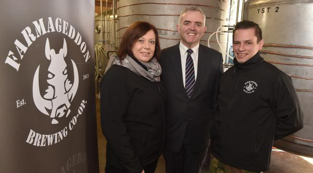 Minister Jonathan Bell with Susan Jackson and Eoin Wilson from Farmageddon Brewing