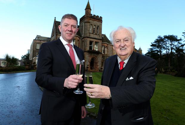 Sir William Hastings of Hastings Hotels and Adrian McNally, general manager of the Culloden, mark 20 years as Northern Ireland's first five-star hotel