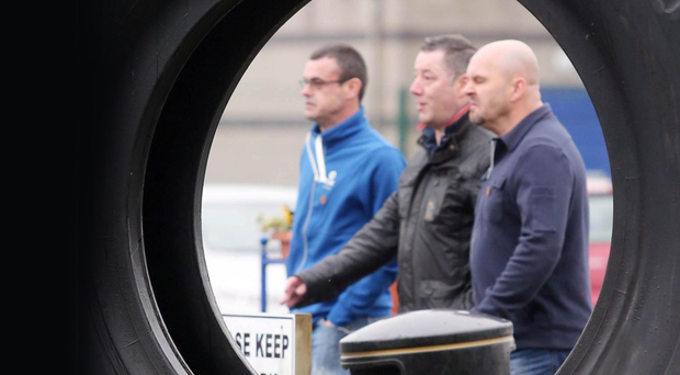 Staff leave the Michelin tyre factory in Ballymena, Co Antrim, in November after the closure announcement