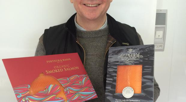 Norman Murray displays packs of Glenarm Organic Salmon and an own-brand product, which are both sold by Fortnum & Mason in London