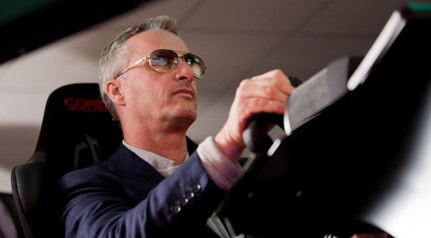 Formula One hero Eddie Irvine is enjoying life in the fast lane of the business world with his firm enjoying an 18% increase in profits