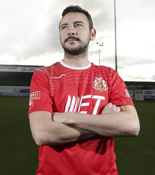 Portadown FC's Michael Gault in a sponsored top