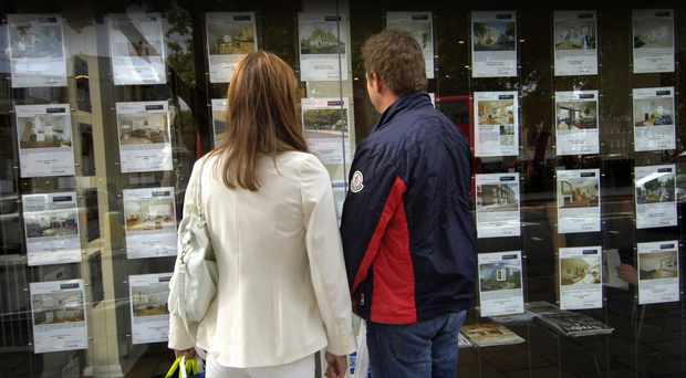 First time buyers...File photo dated 02/09/08 of people outside an estate agent's window in London. PRESS ASSOCIATION Photo. Issue date: Saturday January 24, 2009. It is still cheaper for first-time buyers to rent a home than buy one, despite house prices falling by 16% in the past year, according to a study out today. Houses prices are at their lowest level for five years, relative to income, but the high mortgage rates levied on first-time buyers continue to price them out of the market, according to propertyfinder.com. It would actually be cheaper for people to buy a home rather than rent in 95% of the country, if first-time buyers were given the best borrowing rates. See PA story MONEY FirstTime. Photo credit should read: Tim Ireland/PA Wire...A