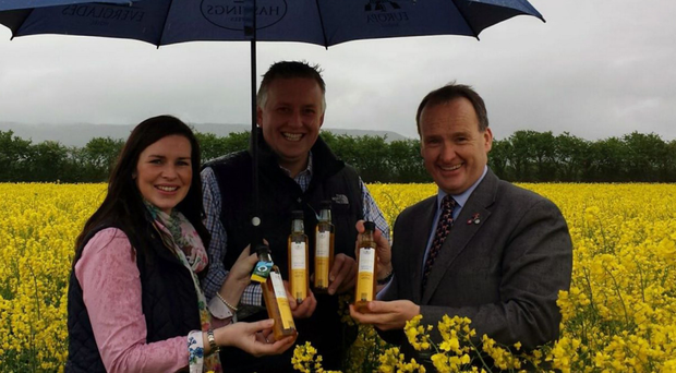 Leona and Richard Kane with their 'liquid gold' rapeseed oil and Howard Hastings (right)