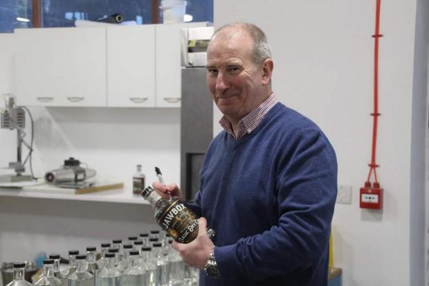 John Hewitt pub manager Gerry White is delighted with his new Jawbox Gin