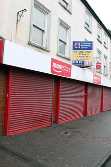 Closed shutters on shops in High Street, Carrickfergus