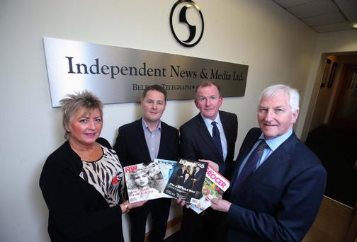 Richard McClean, managing director of the Belfast Telegraph (second right), and Simon Snoddy, finance director of INM Ltd (second left), pictured with Gladys and James Greer from Greer Publications
