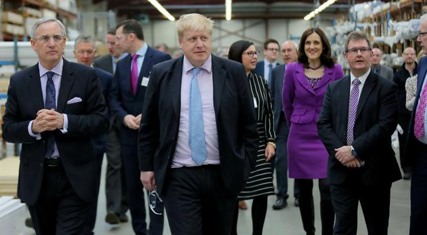 Boris Johnson and Secretary of State Theresa Villiers at Boomer Industries in Lisburn yesterday