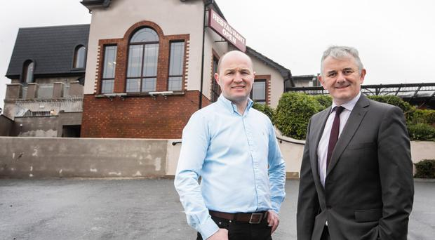 Flagstaff Lodge owner Gary Heaney (left) with Stephen Comer from First Trust Bank