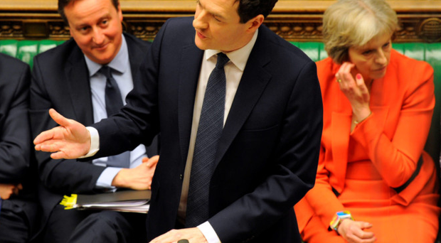 Chancellor George Osborne delivers his budget as PM David Cameron looks on