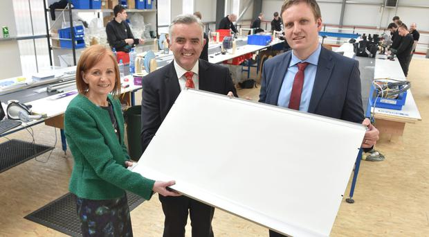 Edel McCooe, Regional Director First Trust Bank, Minister Jonathan Bell and Cormac Diamond, Managing Director Bloc Blinds