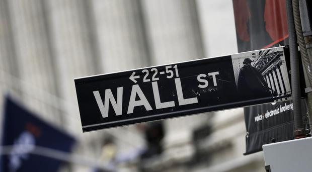 The Dow Jones industrial average edged up 13 points, or 0.1%, to 17,515 (AP)