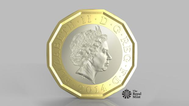 The new pound coin has 12 sides (HM Treasury/PA)