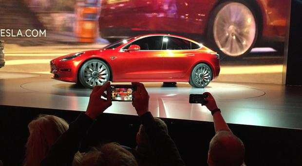 Tesla Motors unveils the new lower-priced Model 3 sedan in California (AP)