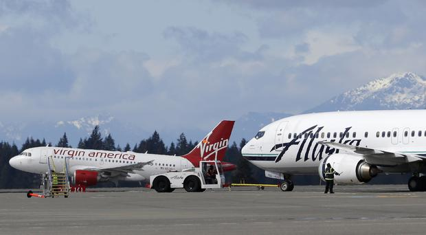 Alaska Air is buying Virgin America (AP)