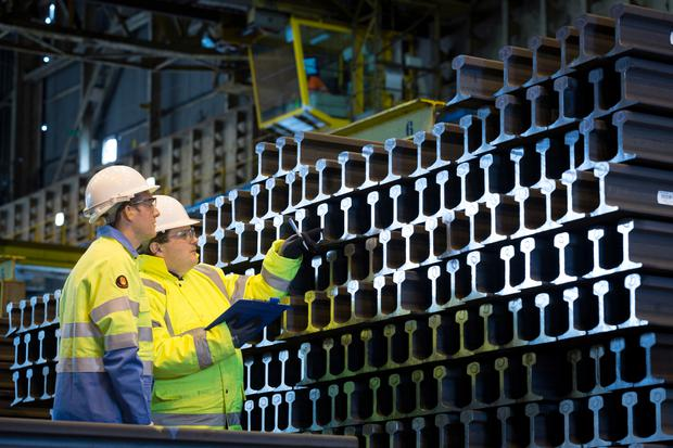 Tata workers examine products at the company's plant in Scunthorpe, England