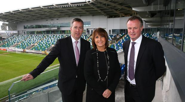 Northern Ireland manager Michael O'Neill, Paul Stapleton, Electric Ireland, and Ann McGregor, NI Chamber at Windsor Park