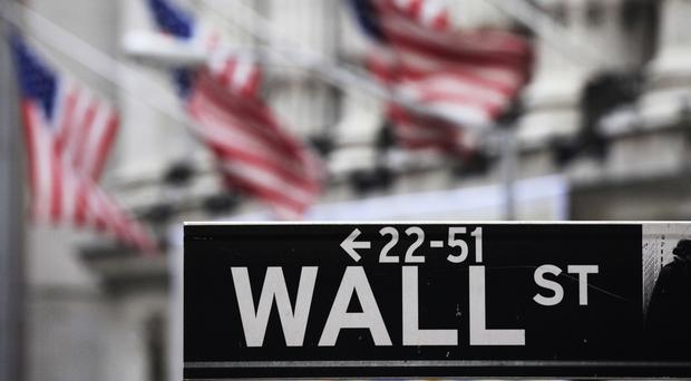 The Dow Jones industrial average rose 164 points, or 0.9%, to 17,721 (AP)