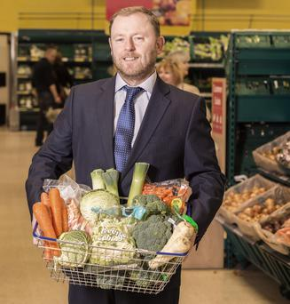Tesco commercial manager Sean Largey with a basket of produce