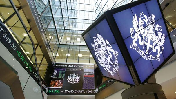 The FTSE 100 Index edged lower - down 8.9 points to 6401.4