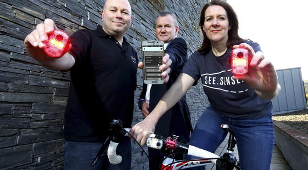 Philip McAleese (left), See.Sense co-founder chief and marketing officer, and Irene McAleese (right), See.Sense co-founder and chief executive, along with Brian Ewart, BT head of major deals and business development
