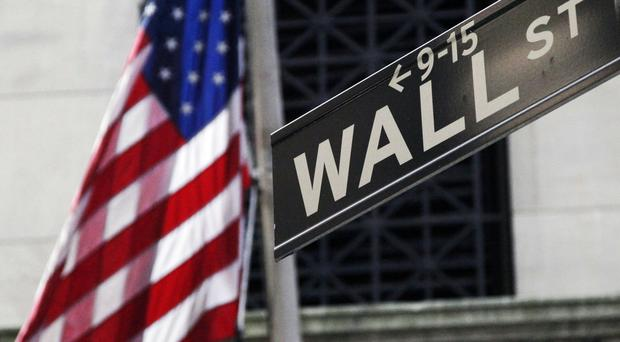 Global stocks fell ahead of policy decisions by the US Federal Reserve and the Bank of Japan (AP)